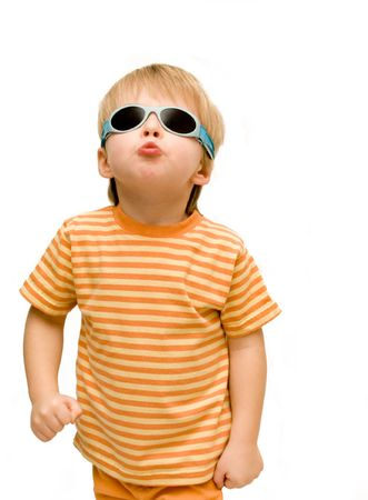 Cheeky 3 year old wearing sunglasses,looking tough. Stock Photo