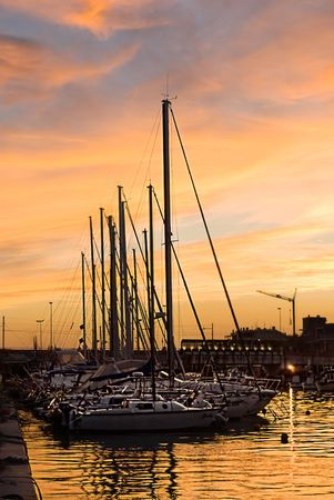 Yachts in the sunset in Rimini, Italy. Stock Photo