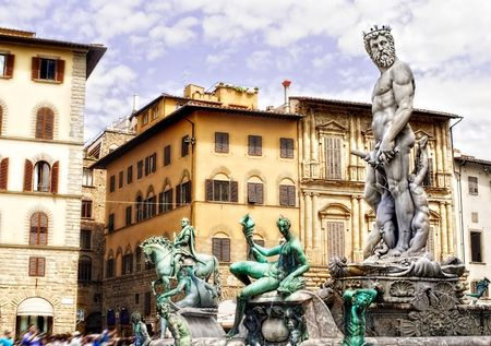 Neptune Statue in Florence, Italy with classic Italian architecture in the back.