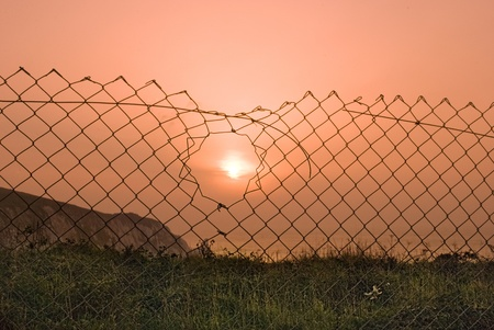 fencing wire: Sunset through wire fencing on the Isle of Wight