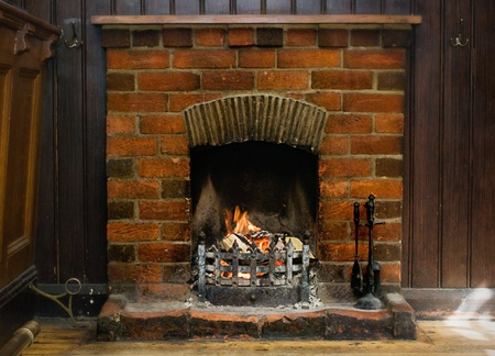 Old Brick Fireplace burning logs. Stock Photo - 13049567