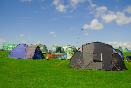 Various tents on a campsite.