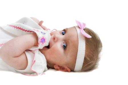 Baby girl holding her dress Stock Photo - 13606862