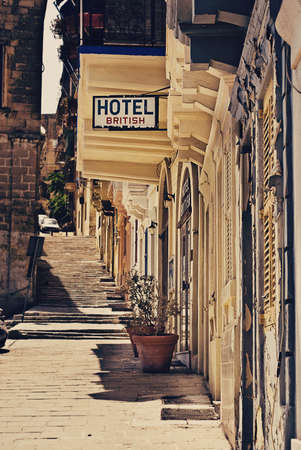 Very old run down hotel sign in Valetta, Malta   Editorial
