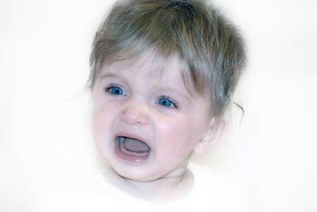 Crying Teething baby girl.  Stock Photo