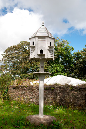 Image of a white dovecote in the country side  Stock Photo