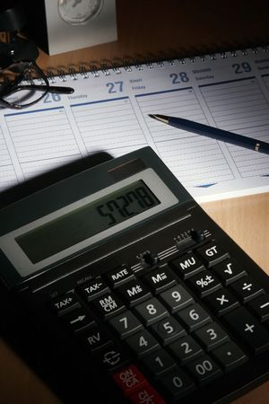 date book: Date book on desk with calculator, glasses, pen... Stock Photo