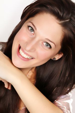 Portrait of a smiling young woman with black hair Stock Photo - 5061491