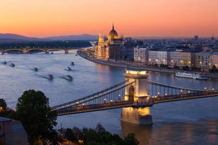 the danube: Budapest cityscape sunset with Chain Bridge in front over Danube river and Parliament Building in the background