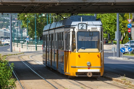 elisabeth: Yellow tram under Elisabeth Bridge on the river bank of Danube in Budapest, Hungary