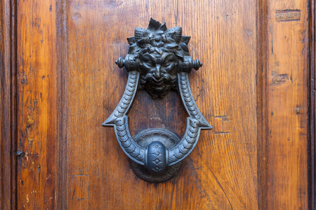knocker: Old door knocker in the form of a demon head, Florence, Italy