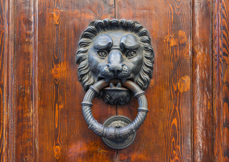 doorknocker: Old door knocker in the form of a lion head, Florence, Italy Stock Photo