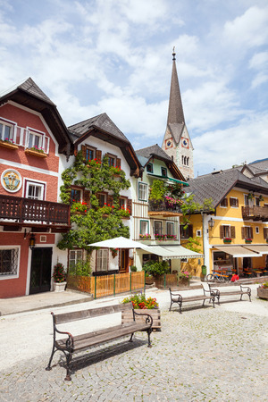 public houses: Public water fountain with colorful houses village marketplace square in Hallstatt, Austria