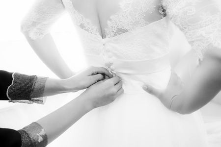 buttoned: Bride getting dressed and buttoned