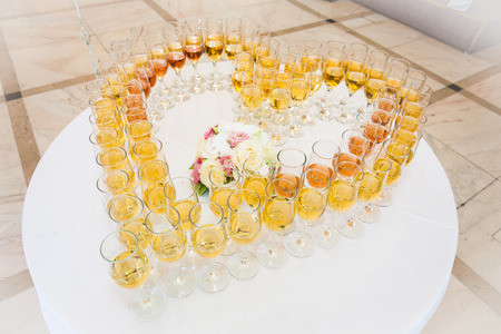 Festive glasses arranged in a heart shaped form photo