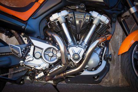 Motorbike engine with exhaust pipes photo