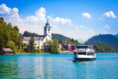 waterbus: Water bus crossing Wolfgangsee and arriving in St. Wolfgang, Austria