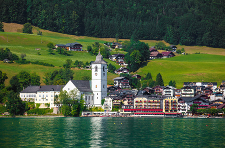 wolfgang: View of St. Wolfgang village waterfront at Wolfgangsee lake with beach toys in front, Austria