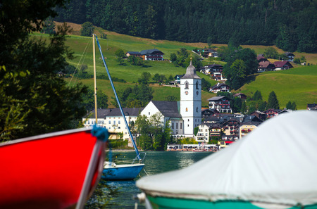 View of St. Wolfgang village waterfront at Wolfgangsee lake with beach toys in front, Austria photo