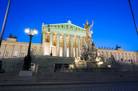 Austrian Parliament Building and The Athena Fountain at night. photo