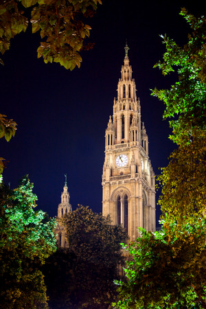 Gothic building tower of Vienna city hall, Rathause, at night, Austria photo