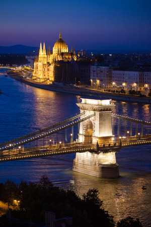 Budapest cityscape sunset with Chain Bridge in front over Danube river and with Parliament Building in the background. photo