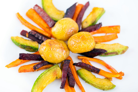 Plate ful of vegetable cooked with potato, beetroot, avocado and carrot chips Stock Photo