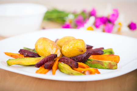 ful: Plate ful of vegetable cooked with potato, beetroot, avocado and carrot chips Stock Photo