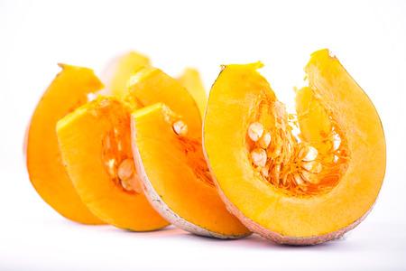 Pumpkin slice isolated on white photo
