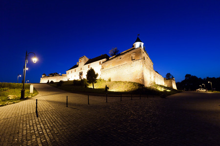 cetatuia: Old fortress Cetatuia illuminated at night, Brasov, Romania