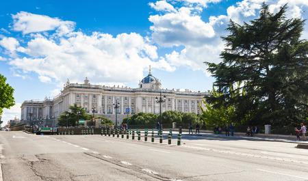 palacio: Madrid, Spain - May 6, 2012: Royal palace (Palacio Real de Madrid) with tourists on spring day in Madrid, Spain Editorial