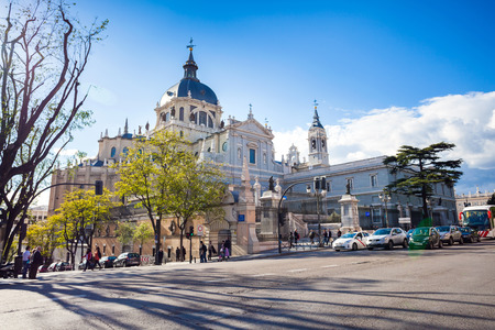 real madrid: Madrid, Spain - May 6, 2012: Cathedral Almudena with tourists on a spring day in Madrid, Spain