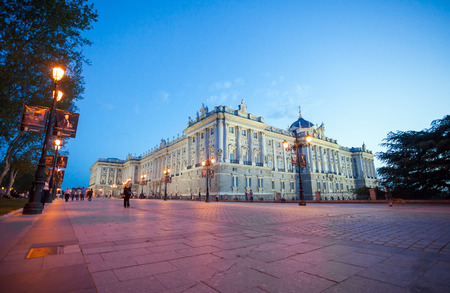 real madrid: Madrid, Spain - May 10, 2012: Royal palace (Palacio Real de Madrid) with visiting tourists on a spring night in Madrid, Spain