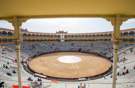 toros: Madrid, Spain - May 11, 2012: Plaza de Toros de Las Ventas interior view with tourists gathering for the bull show in Madrid on a sunny day, Spain