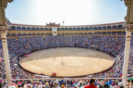 plaza de toros: Madrid, Spain - May 11, 2012: Plaza de Toros de Las Ventas interior view with tourists gathering for the bull show in Madrid on a sunny day, Spain