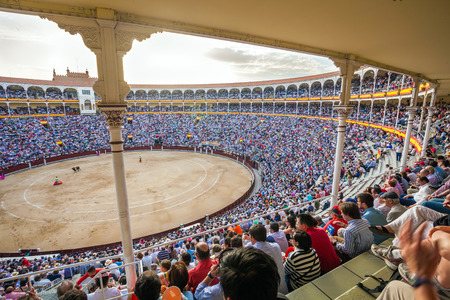 plaza de toros: Madrid, Spain - May 11, 2012: Plaza de Toros de Las Ventas interior view with tourists gathered for the bull show in Madrid on a sunny day, Spain
