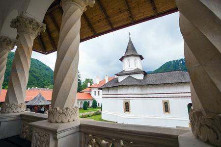 colonade: Church inside Sambata de Sus Monastery seen trough a colonade in Transylvania, Romania