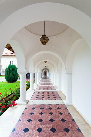 colonade: Arched colonade hallway at Sambata de Sus monastery in Transylvania, Romania