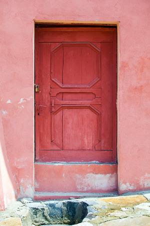 turda:  House facade with pink wood door fron Turda city, Romania Stock Photo