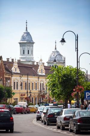 turda: Turda, Romania - June 23, 2013:  Turda old city center view with ortodox church towers on background, Romania