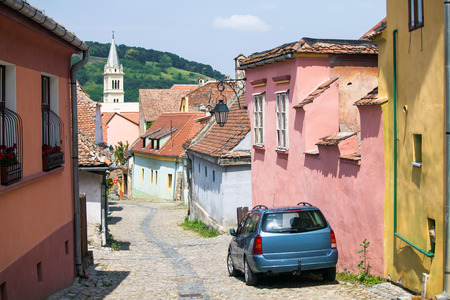 turda: Old paved stone street with colored houses from Old Turda medieval city center, Turda, Romania