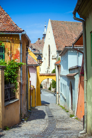 turda:  Old stone paved street with tourists from Sighisoara fortress, Transylvania, Romania Stock Photo