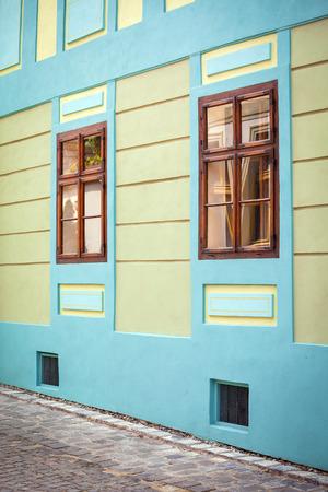 turda: Sighisoara Romania  June 23 2013: Blue house facade with wooden windows from Sighisoara city old center Transylvania Romania