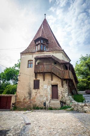 turda: Sighisoara Romania  June 23 2013: Shoemakers tower Turnul Cizmarilor part of  Sighisoara fortress in Transylvania Romania Editorial
