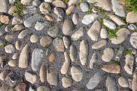 rough background: River rough stones pavement background