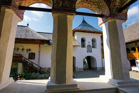 colonade: Polovragi, Romania - September 2, 2012: Inside view of the old orthodox Polovragi monastery seen trough a colonade, Romania