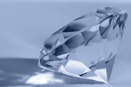 Close-up of shiny diamond. Shallow DOF. Space for text.