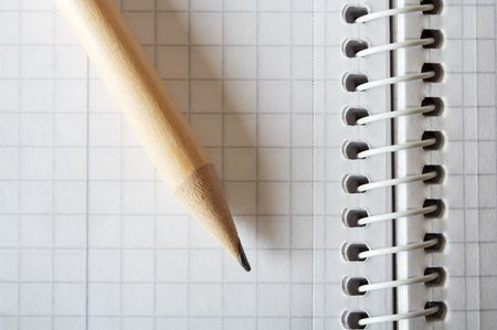 Wooden pencil on spiral bound notebook closeup. Space for text. photo