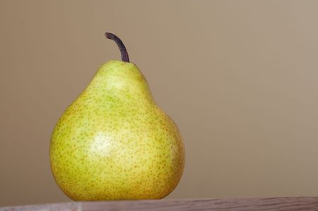 fruitage: Close-up of fresh pear isolated on brown natural background.