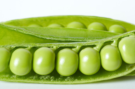 Green peas in pod close-up on white background. Stock Photo - 1380092